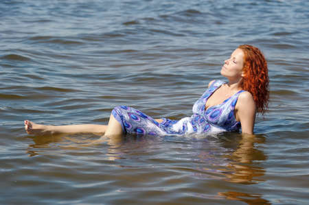young woman in a dress in the water Stock Photo - 14191280