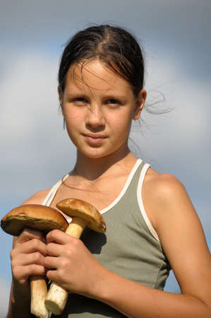 The girl with ceps in hands Stock Photo - 14191273