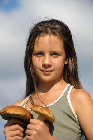 fungous: The girl with ceps in hands