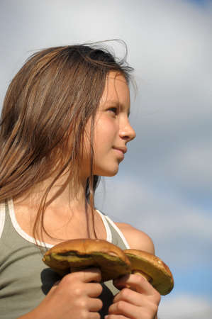 boastful: The girl with ceps in hands