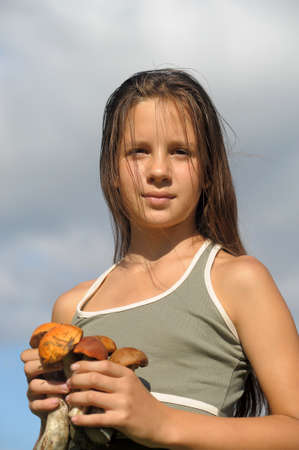 The girl with ceps in hands photo