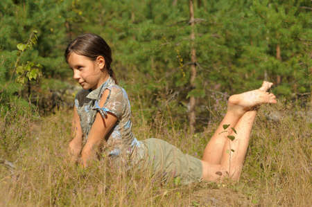 teen girl lying in grass photo