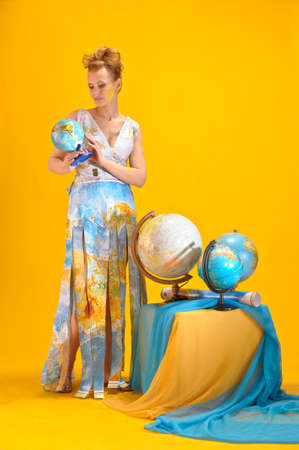 Young blonde woman with globe Stock Photo - 14195636