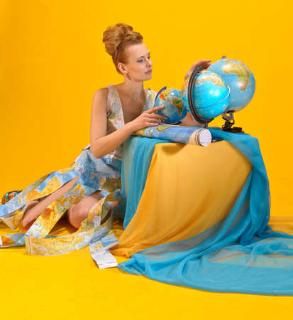 Young blonde woman with globe  photo