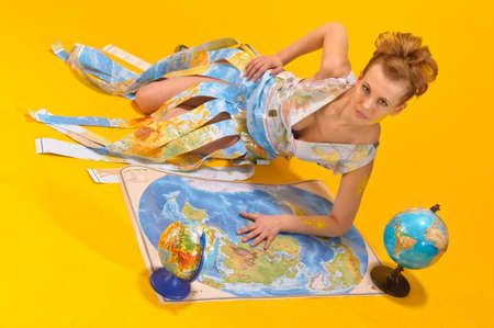 Young blonde woman with globe  Stock Photo - 14195643
