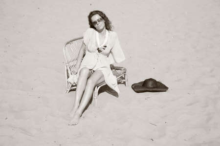young woman sitting on the beach Stock Photo - 14202743