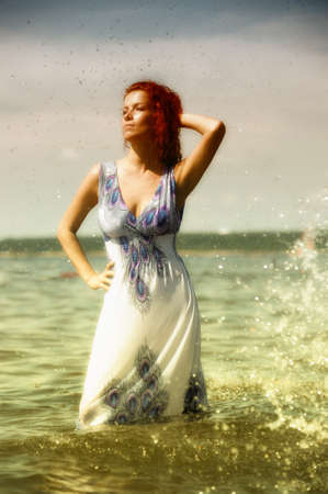 erotic fantasy: Young woman playing with water