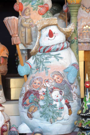 Ancient Russian wooden snowman photo
