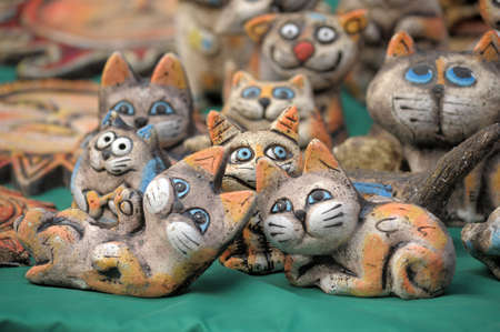 Amusing ceramic figures of cats photo