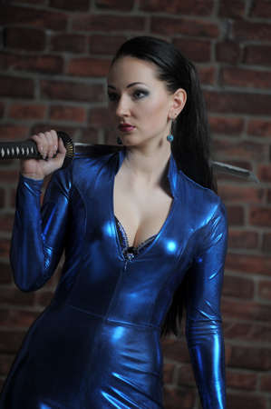 girl in a blue suit with a fitting close katana in hands Stock fotó