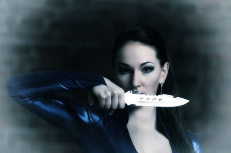 The woman with a knife in a hand photo