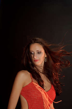 ambiguous: Beautiful dark-haired woman in a red dress Stock Photo