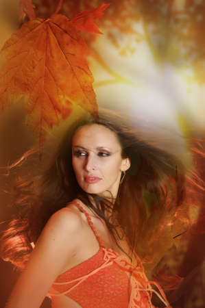 involve: Autumn portrait of a beautiful young woman Stock Photo