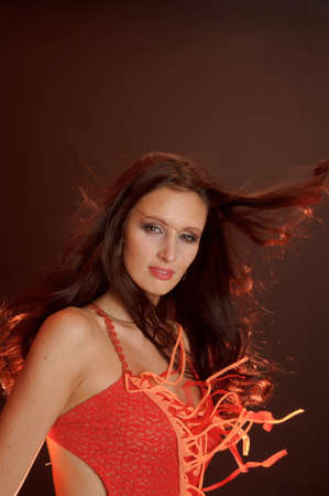 Beautiful dark-haired woman in a red dress photo