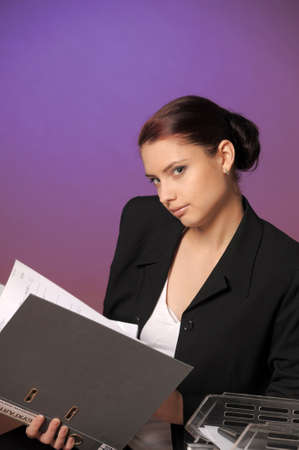Young secretary or businesswoman in suit with notebook Stock Photo - 14232219