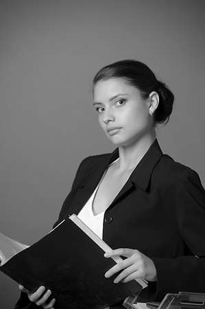 Young secretary or businesswoman in suit with notebook Stock Photo - 14232411