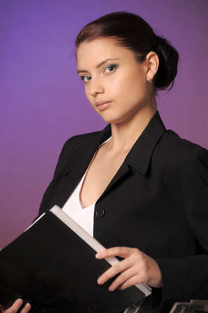 Young secretary or businesswoman in suit with notebook Stock Photo - 14232216