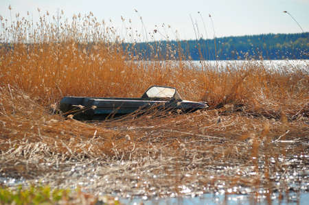 inverted boat-drying on the shore photo