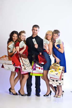 women with shopping bags take money from the man Stock Photo - 14235433
