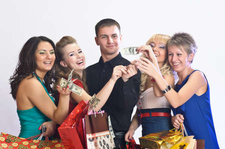women with shopping bags take money from the man Stock Photo - 14235427