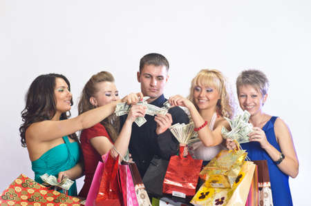 women with shopping bags take money from the man photo