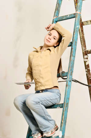 The girl is the house painter Stock Photo - 14235630