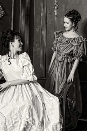 Two ladies in medieval dresses, sepia photos Stock Photo - 14235661