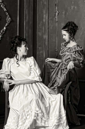 Two ladies in medieval dresses, sepia photos Stock Photo - 14235643