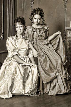 Two ladies in medieval dresses, sepia photos Stock Photo - 14235674