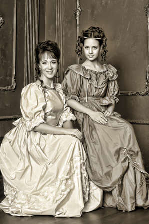 Two ladies in medieval dresses, sepia photos photo