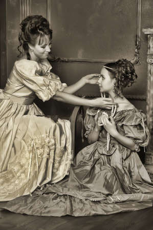 historical clothing: Two ladies in medieval dresses, sepia photos Stock Photo