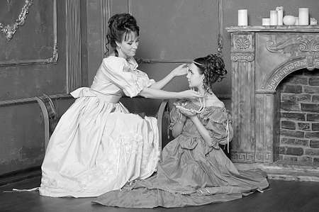 Two ladies in medieval dresses, black and white photo photo