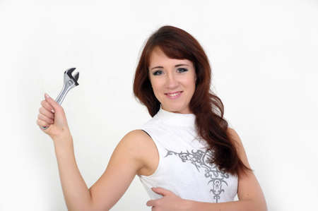 Beautiful young do-it-yourselfer holding a screw-wrench