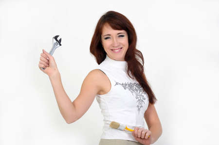 Beautiful young do-it-yourselfer holding a screw-wrench Stock Photo - 14229271