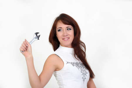 Beautiful young do-it-yourselfer holding a screw-wrench Stock Photo - 14235624