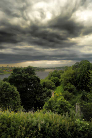 storm clouds over the river photo