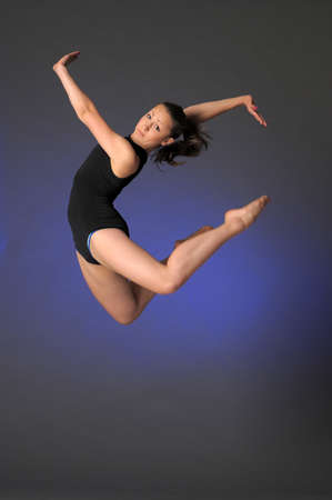 gymnast in mid-air photo