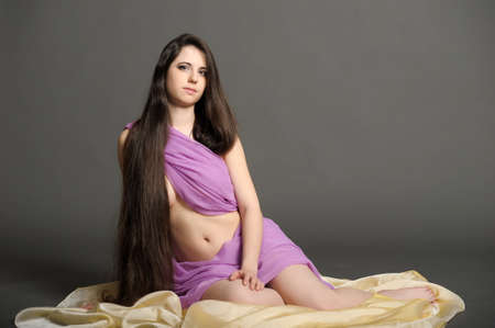 young woman with luxurious long hair photo