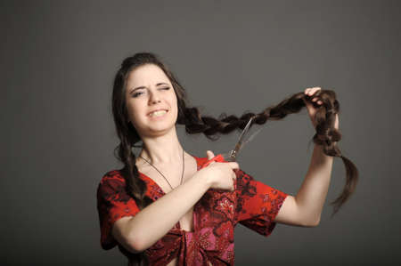 she does not want to cut the braids Stock Photo - 18184127