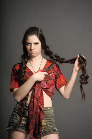 she does not want to cut the braids Stock Photo - 18184168