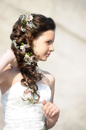 girl with a wedding hairstyle with flowers photo