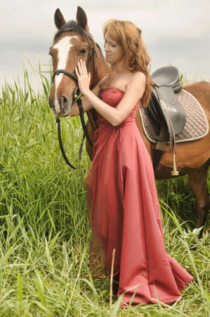 portrait of a young woman and a horse Stock Photo - 14289269