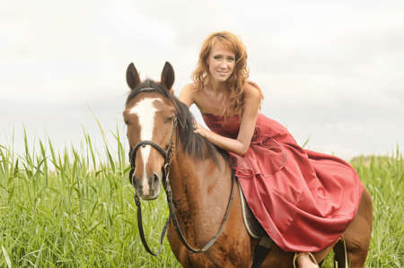portrait of a young woman on a horse photo