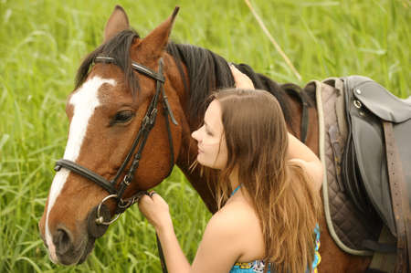 Beautiful young woman and horse photo