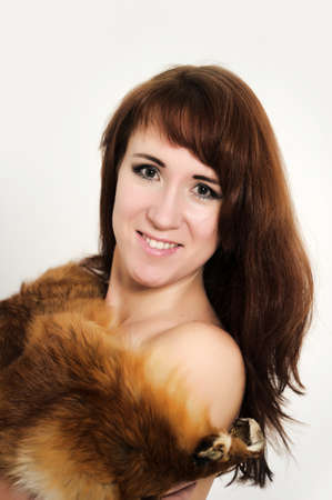 young woman with a fox fur on the shoulders photo