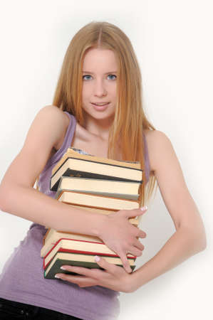 Girl holding a stack of books Stock Photo - 14308516
