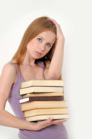 Girl holding a stack of books photo