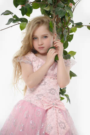 in a pink dress with roses  photo
