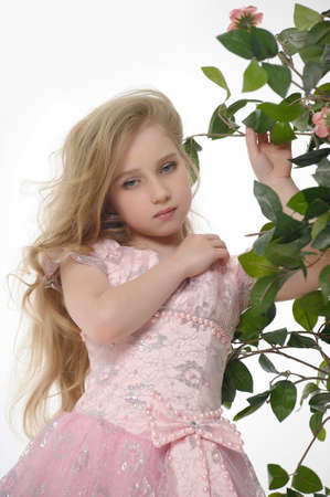 beautiful blonde girl with green eyes: in a pink dress with roses