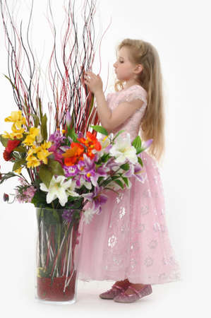 the girl in a pink formal dress with a bouquet of flowers in a vase Stock Photo - 14395219